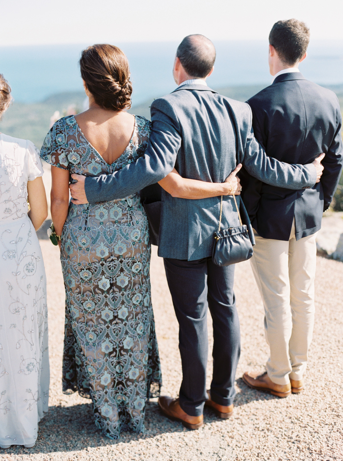bride and groom family with arms around each other