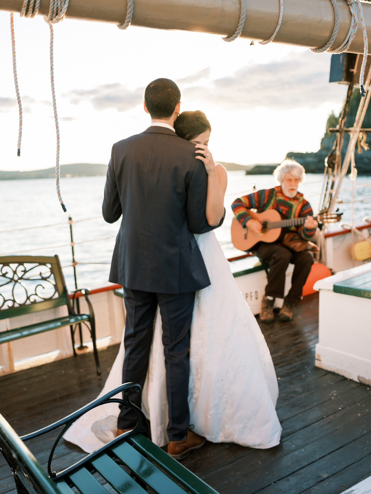 bride and groom embracing during first dance on boat