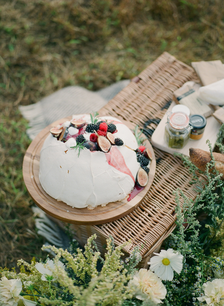wedding cake on wooden tray with figs