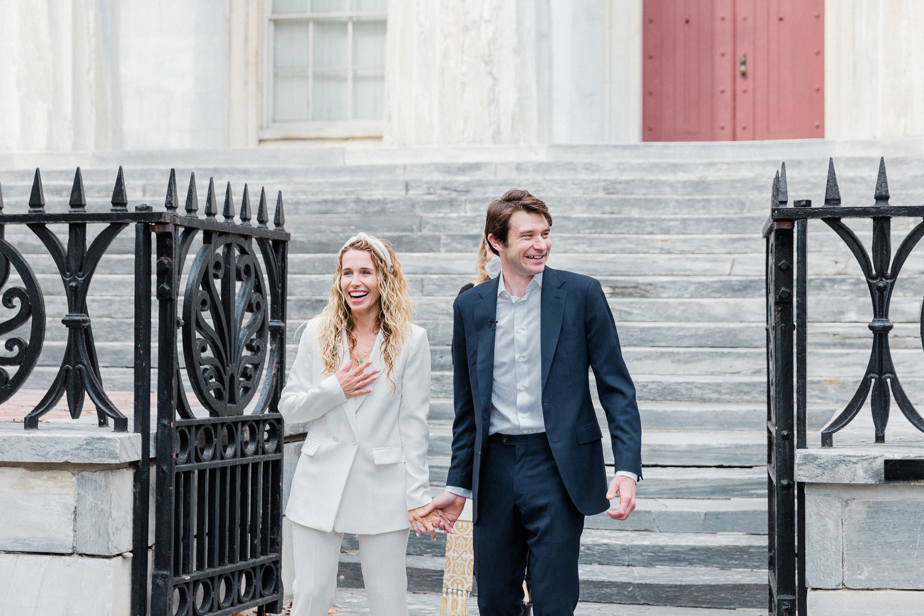 bride and groom on bank steps for small wedding ceremony