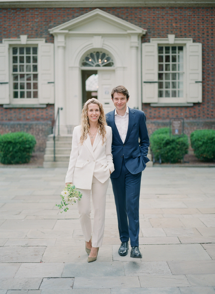 wedding couple in black and white suits portrait