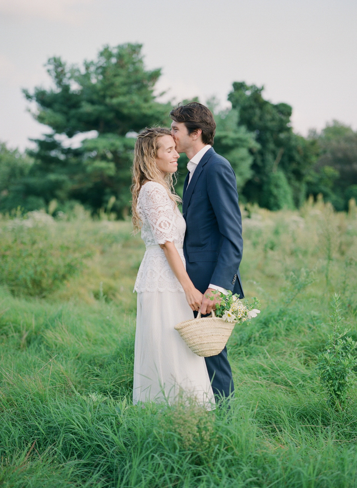 bride and groom portrait in grassy field