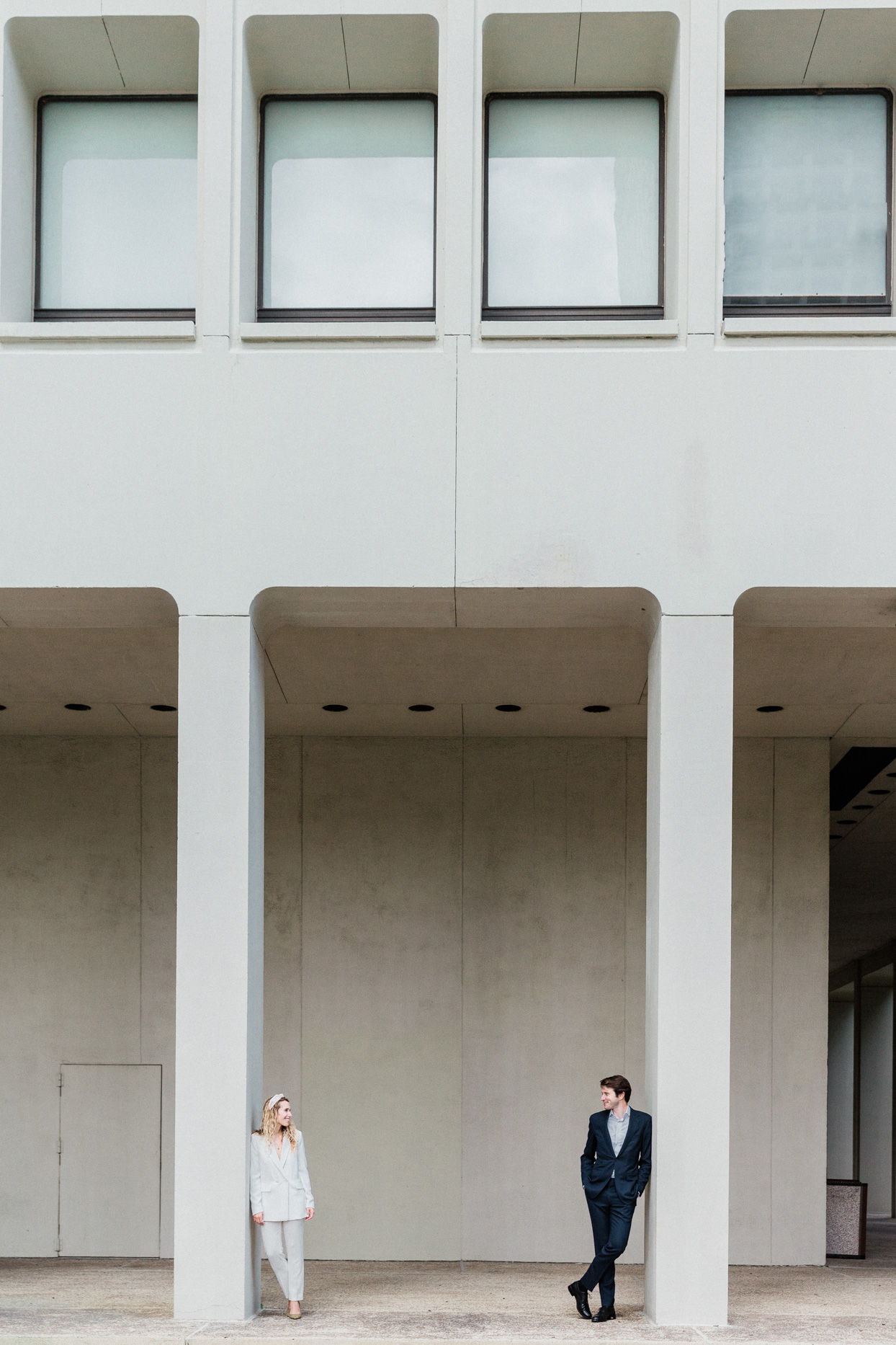 modern wedding portraits in front of large building