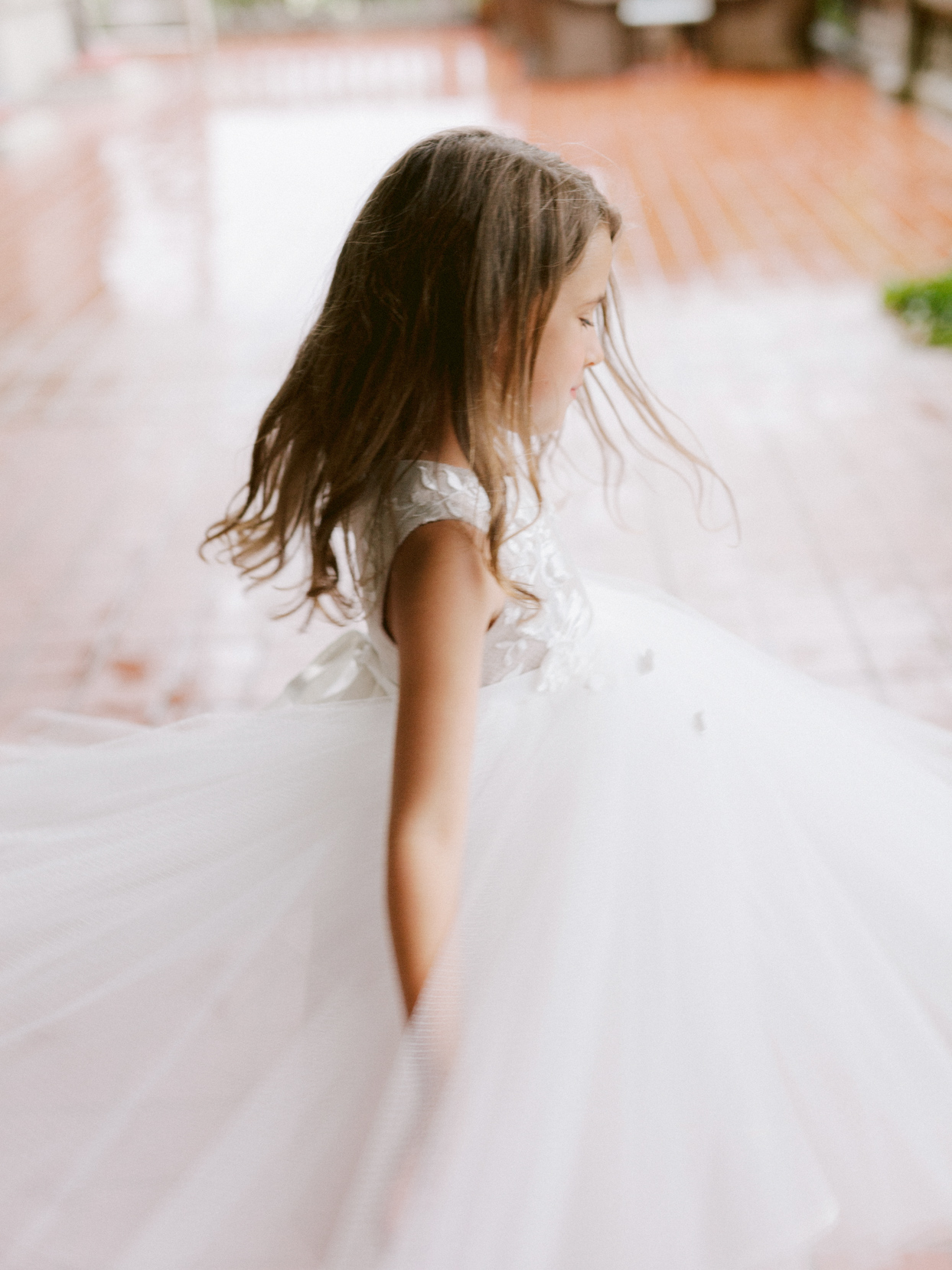 daughter twirling in white tulle dress