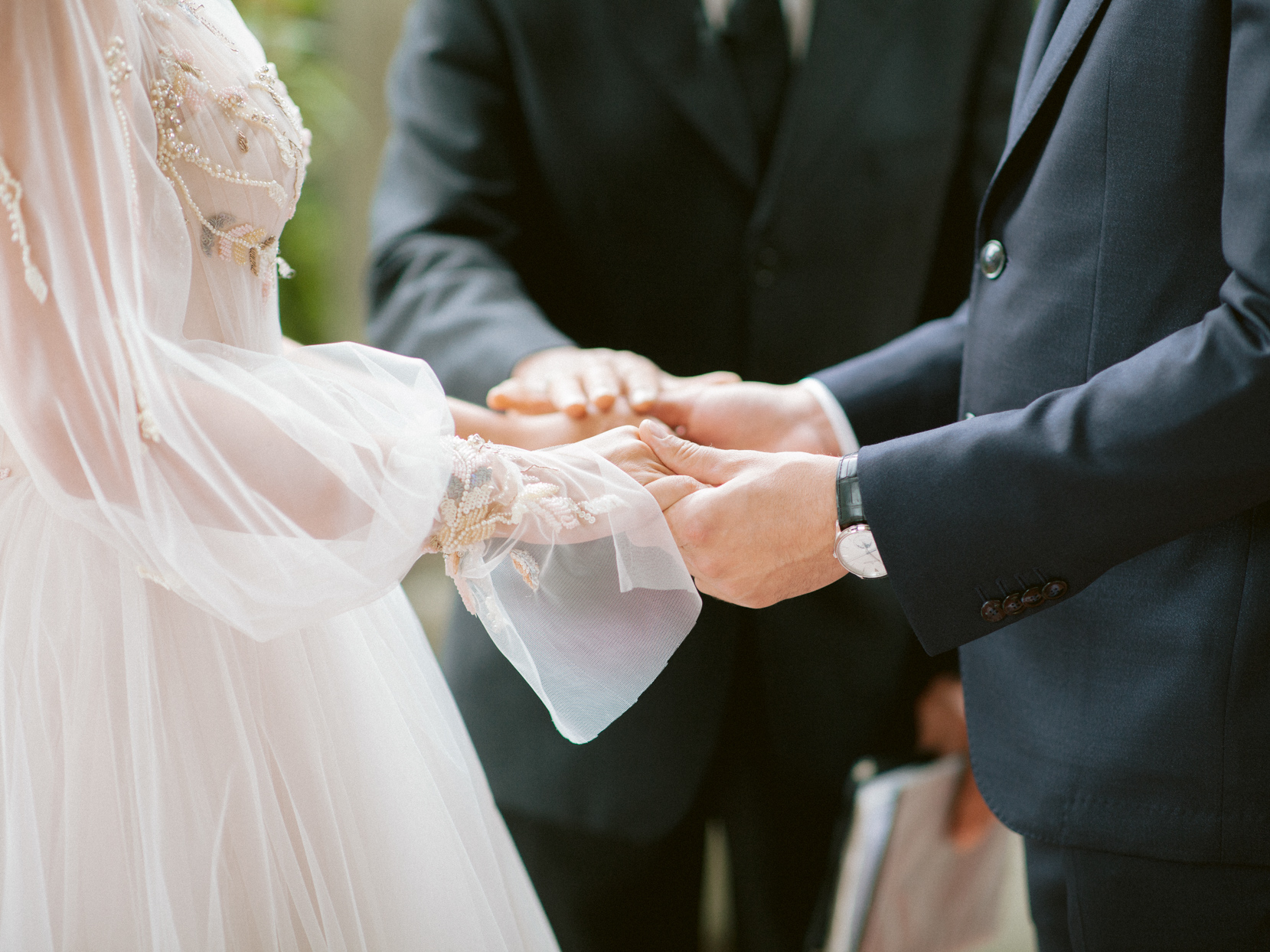 wedding couple holding hands for vows