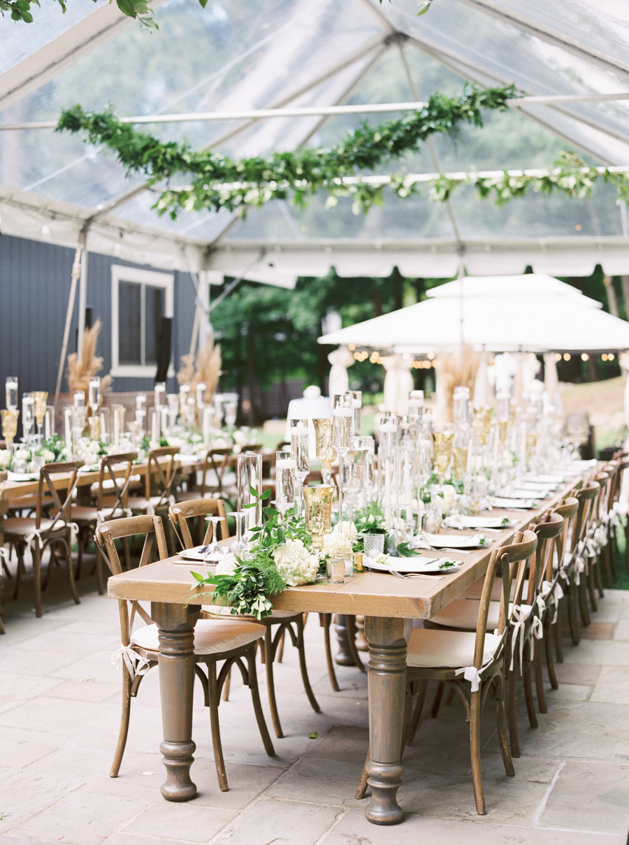 wedding tables with greenery and white floral centerpieces