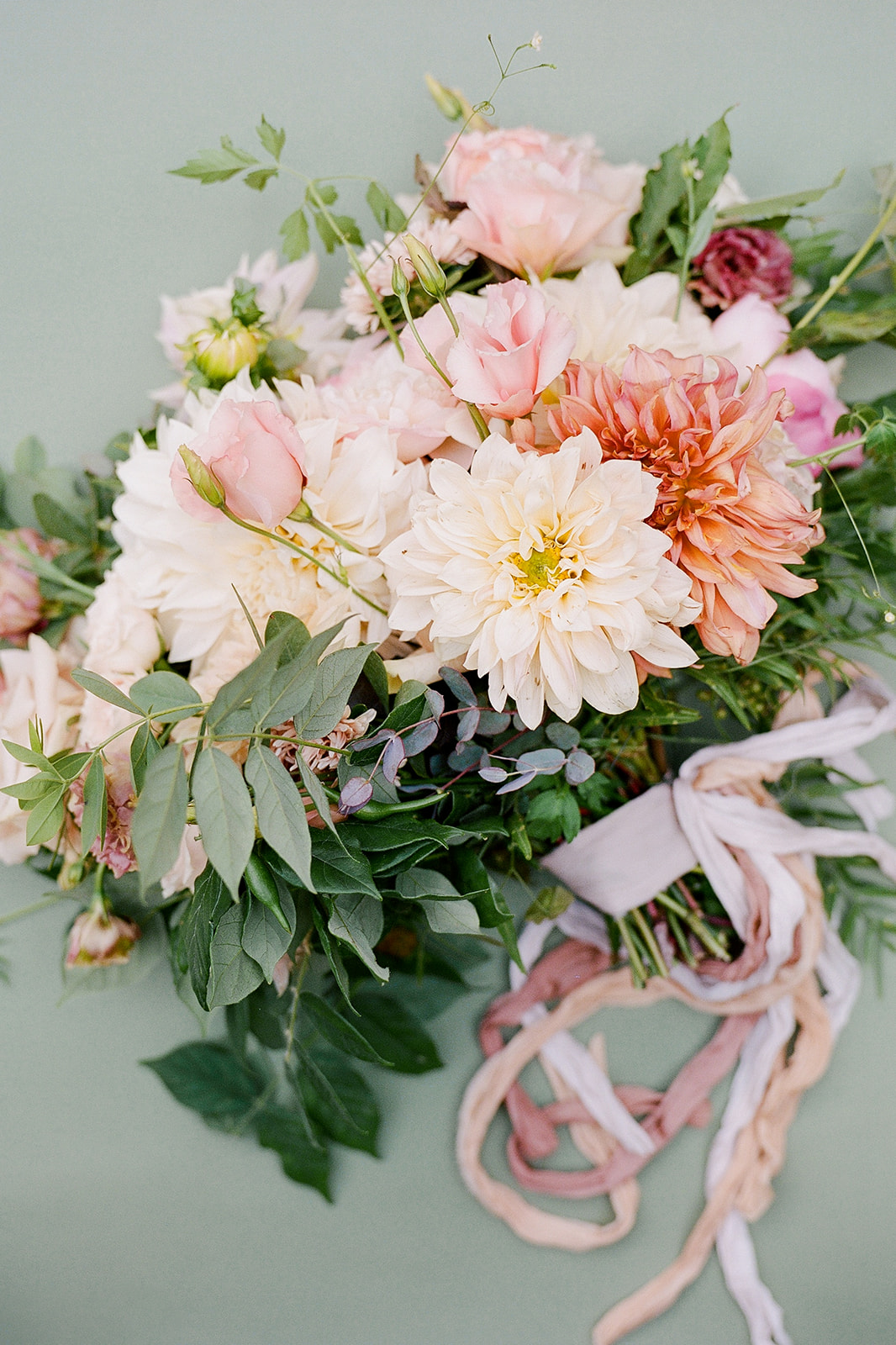 pink floral toned wedding bouquet with ribbon