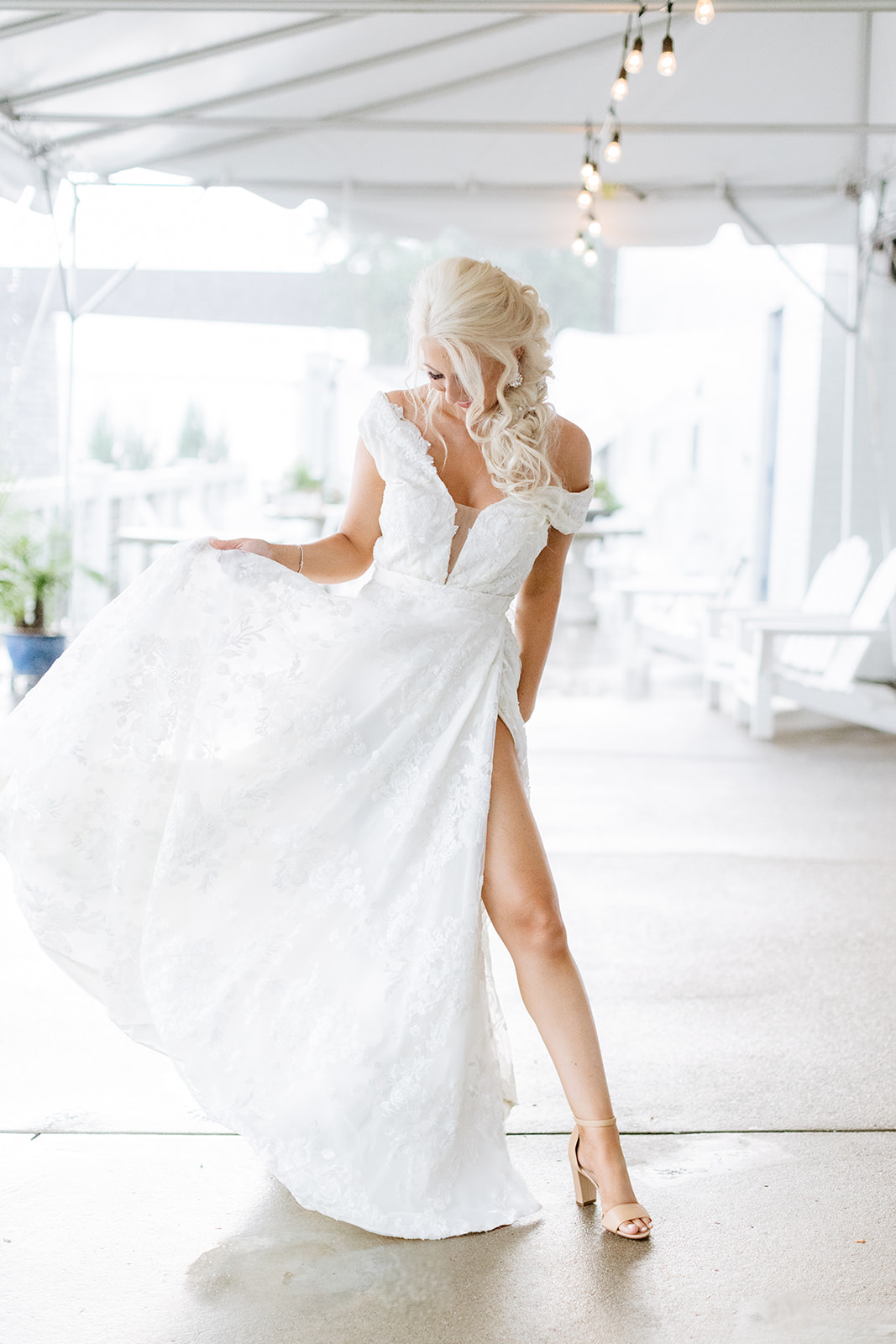 bride wearing second wedding dress with side slit and off the shoulder sleeves