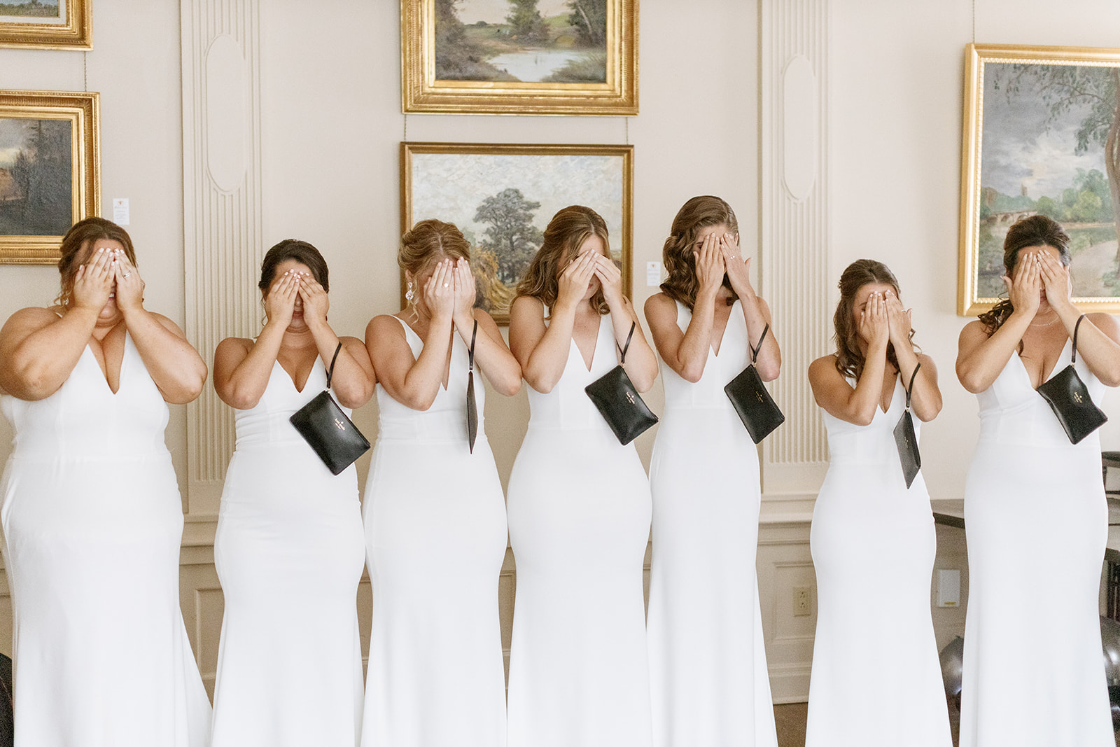 bridesmaids covering their eyes before first look