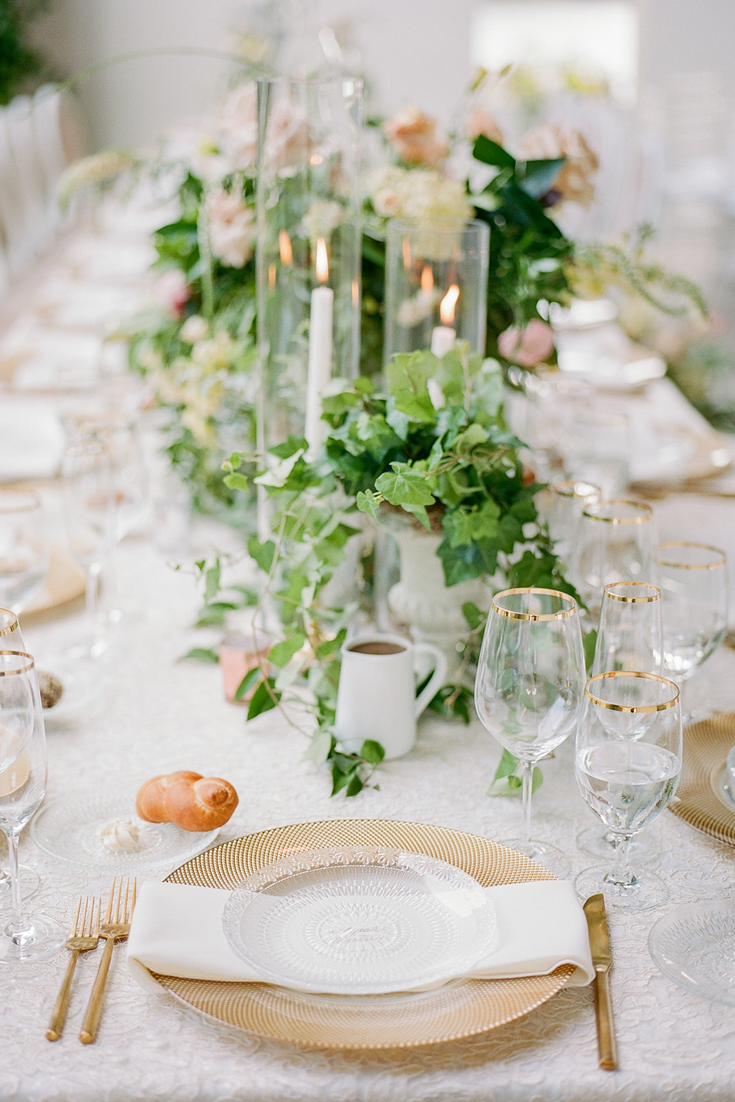 gold trimmed place settings with white linens