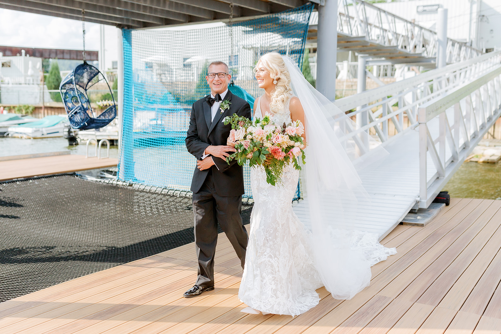 bride walking down boat doc with her father