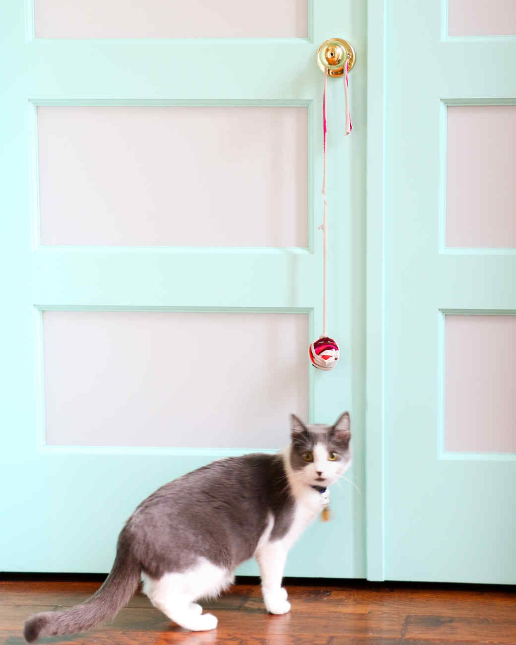 knotted cat toy hanging from doorknob