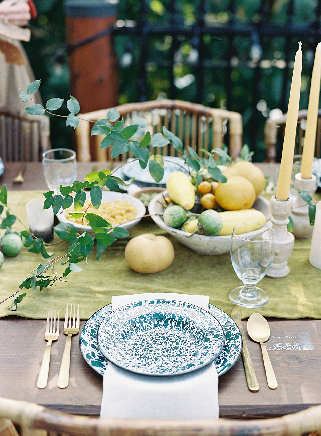 splattered place settings with gold silverware