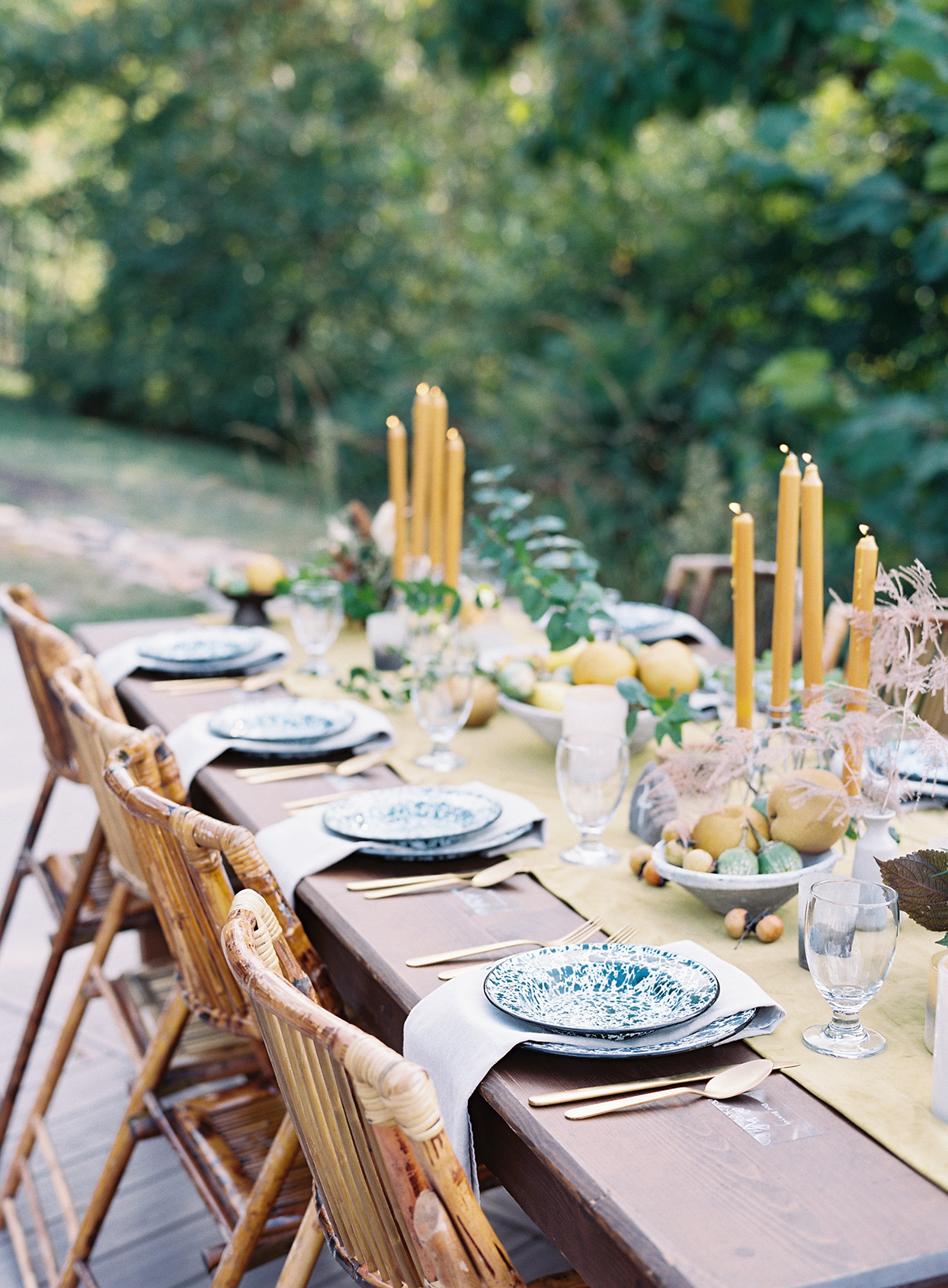 yellow taper candles with bowls of fruit reception table centerpieces