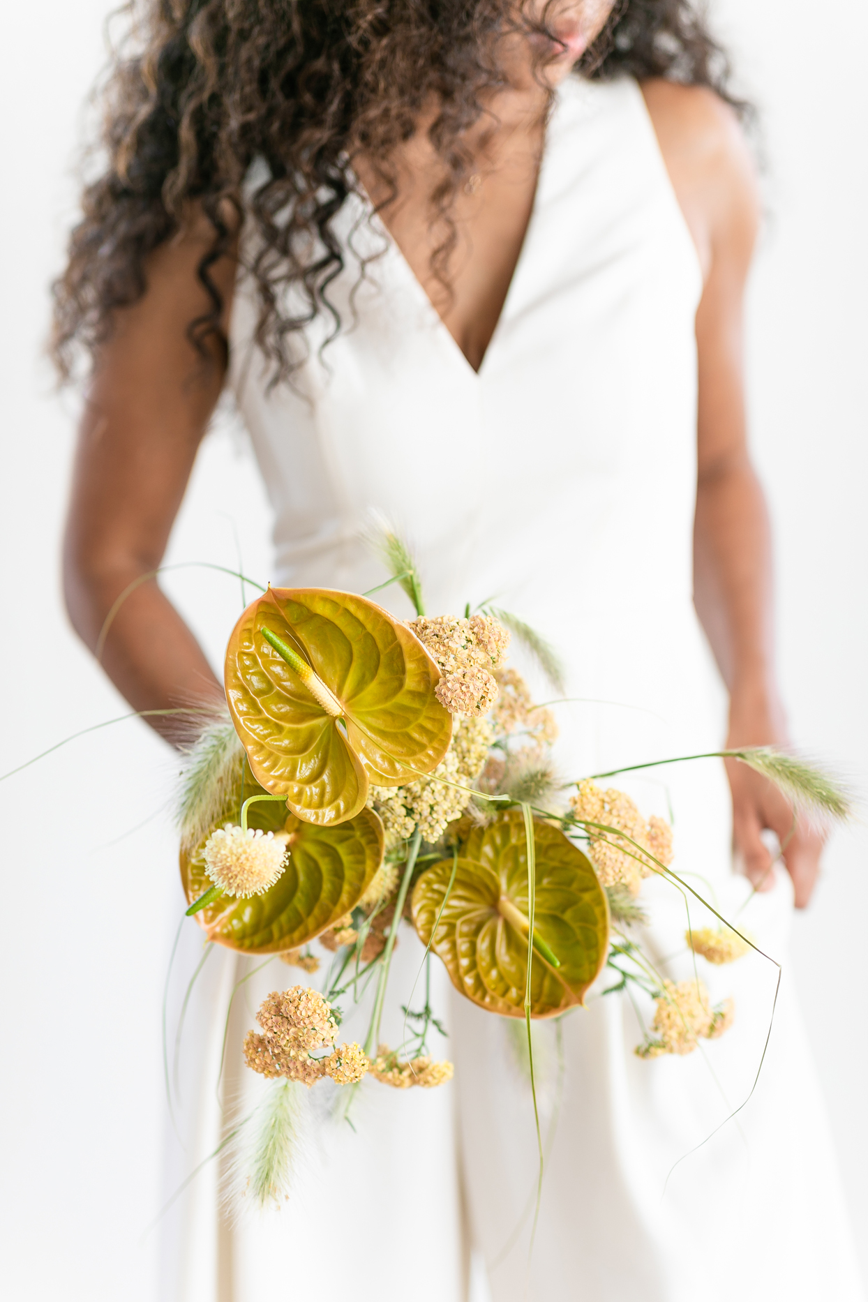 bridal bouquet of greenish-gold anthurium lilies and soft ferns