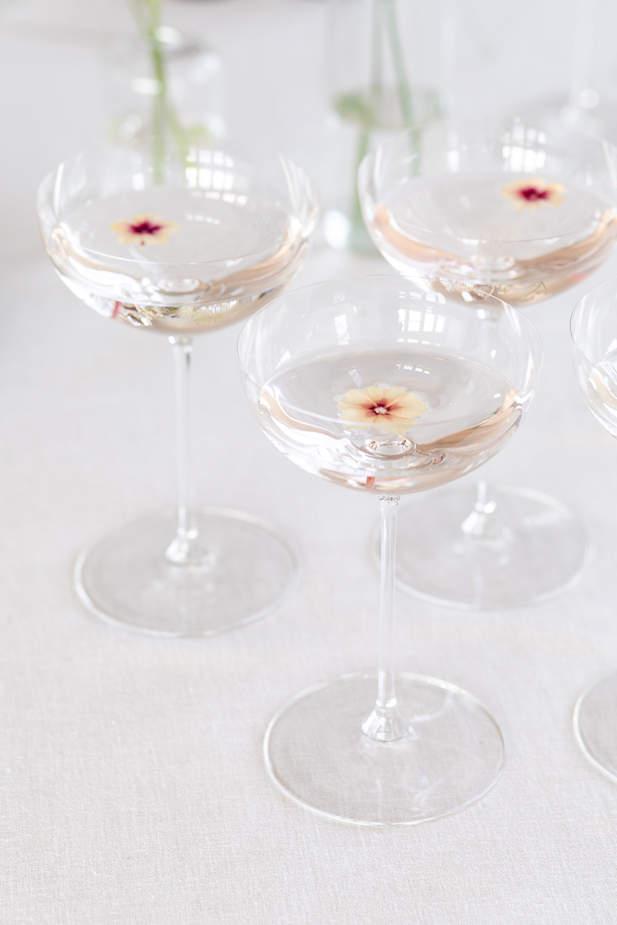 champagne coupes topped with delicate flowers