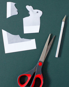 cutting out image of rabbit with scissor and xacto knife