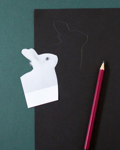 tracing image of rabbit on black card stock