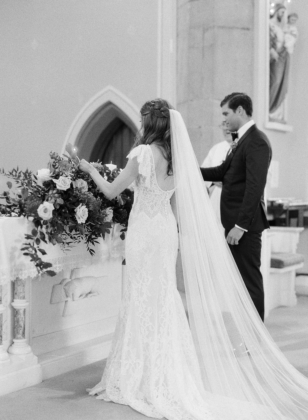 bride and groom lighting church candles