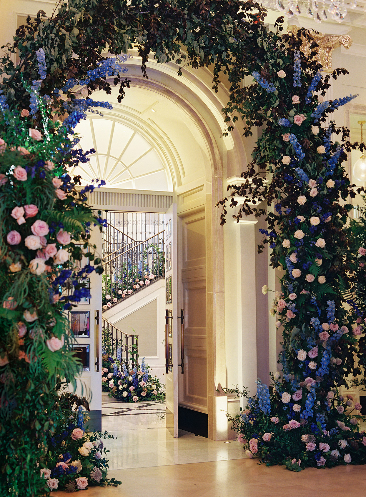 large blue and pink floral arch