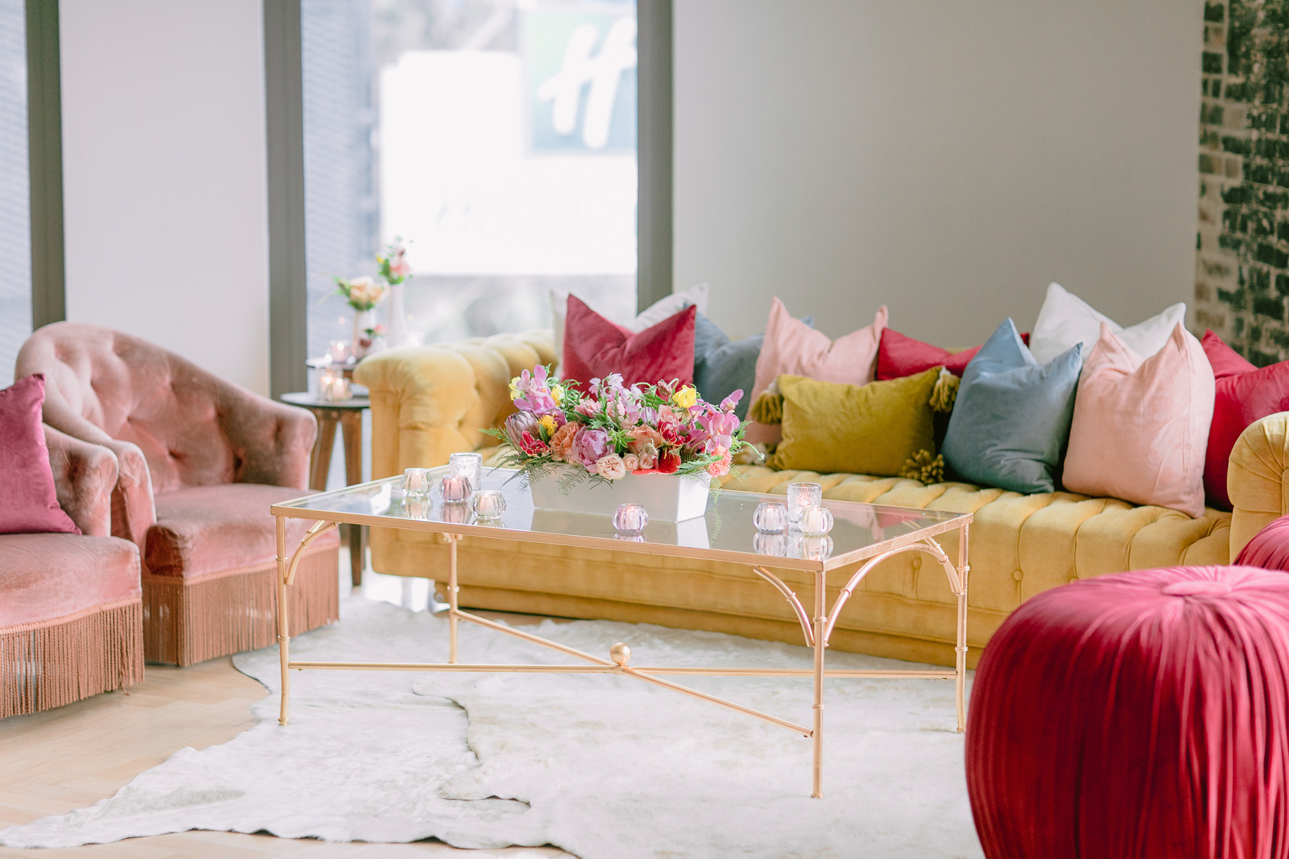 colorful pink and yellow reception lounge