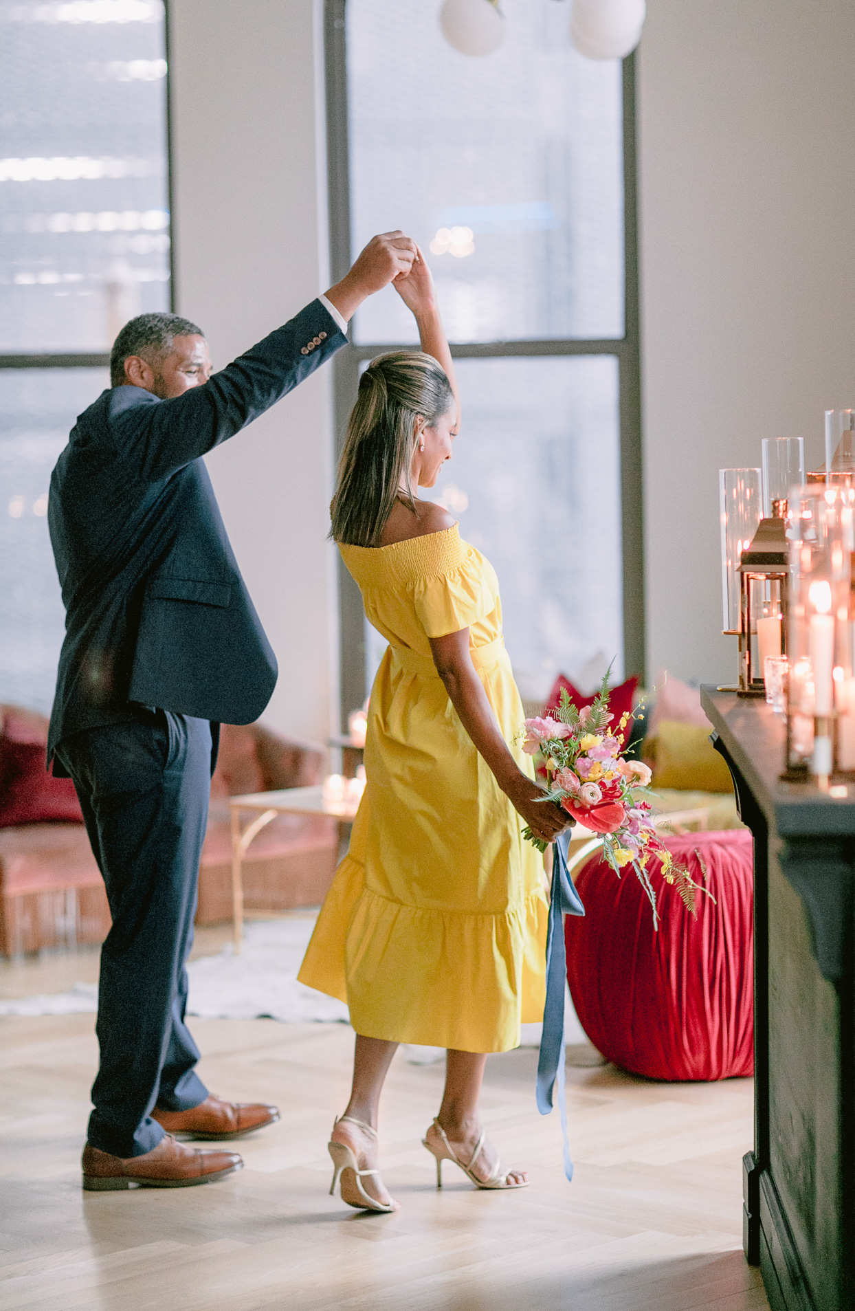 couple twirling for first dance