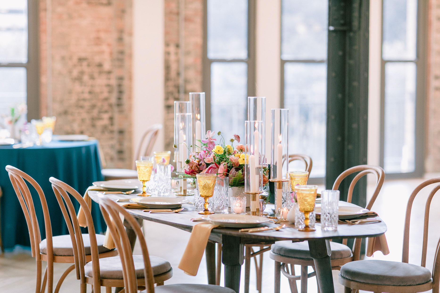 small wooden table with elegant colorful reception decor