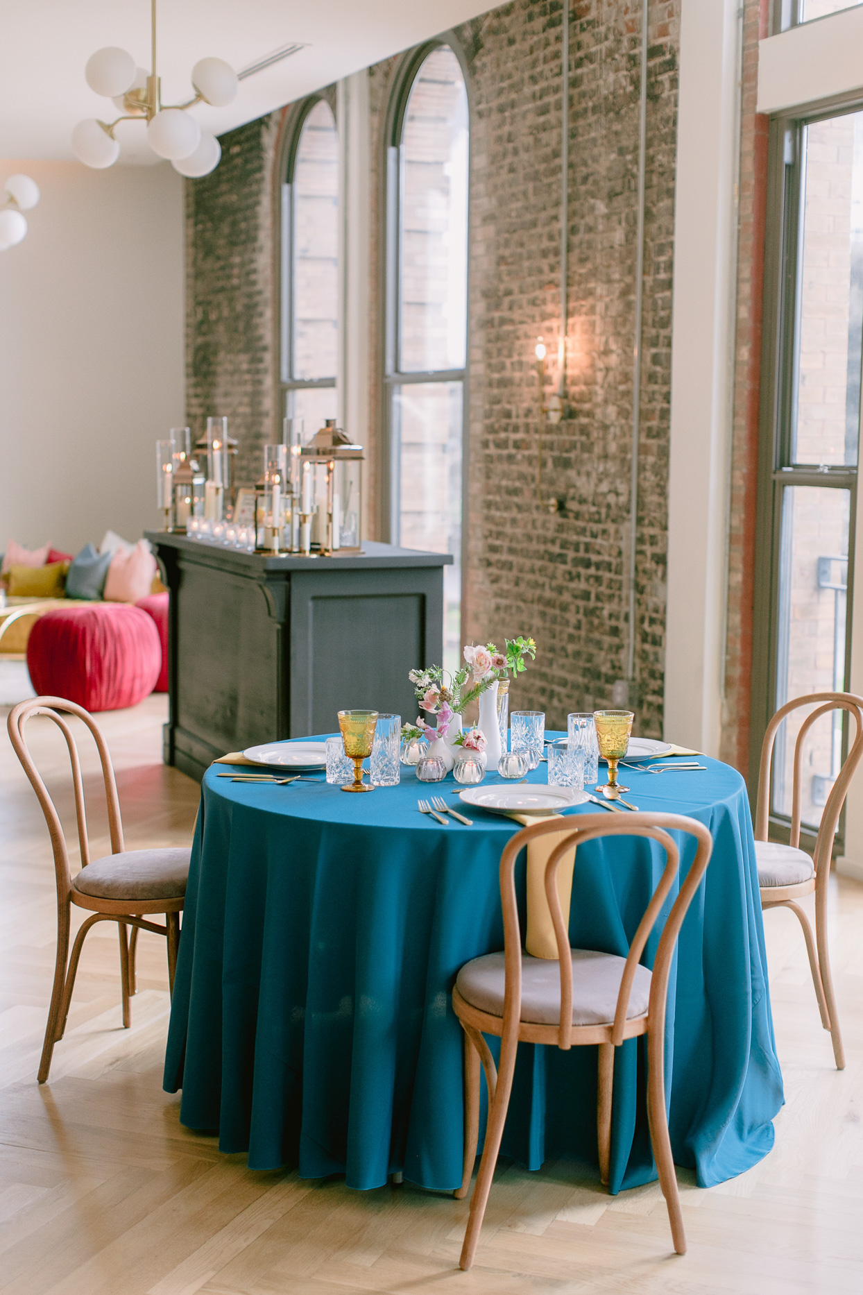 round table with teal cloth and floral decorations
