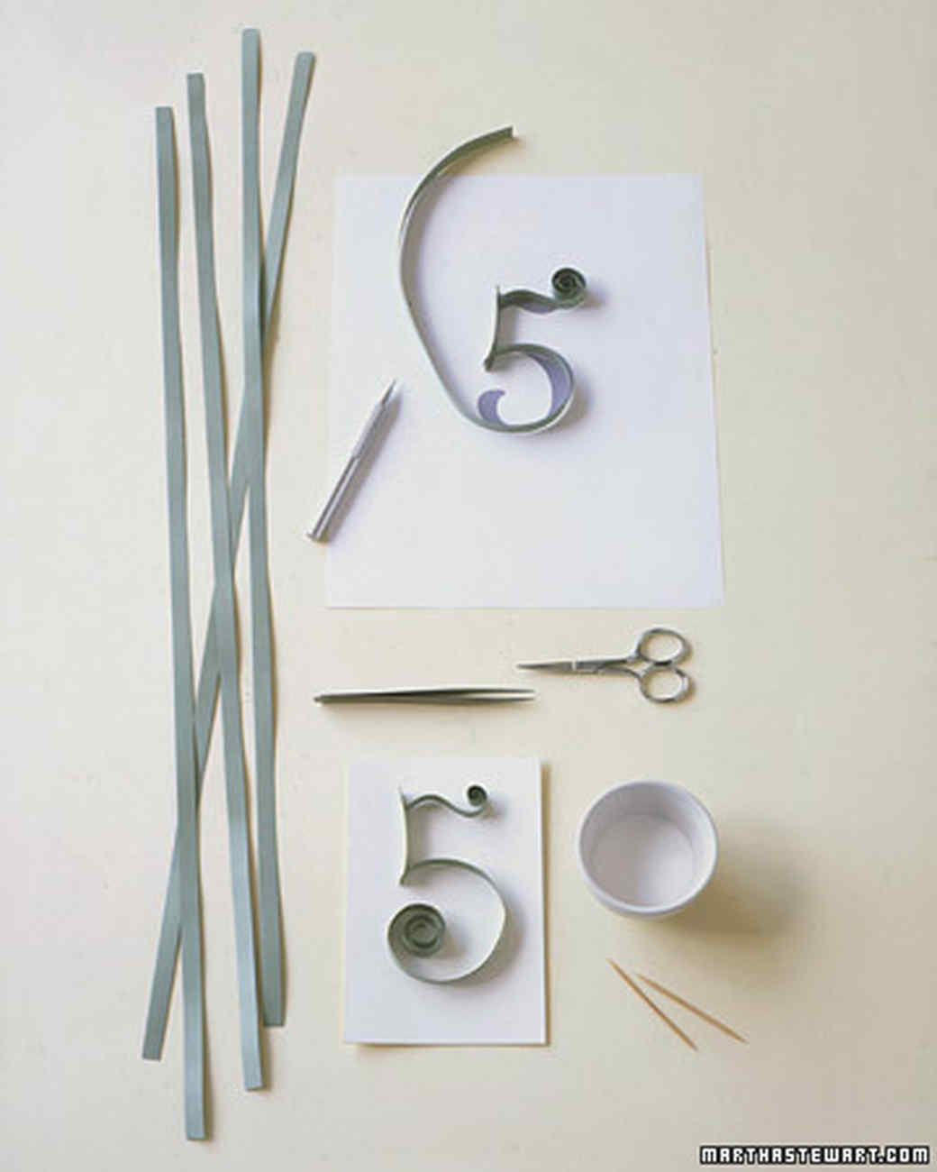 Apply white craft glue to edge of number with toothpick, and attach to card, using tweezers.