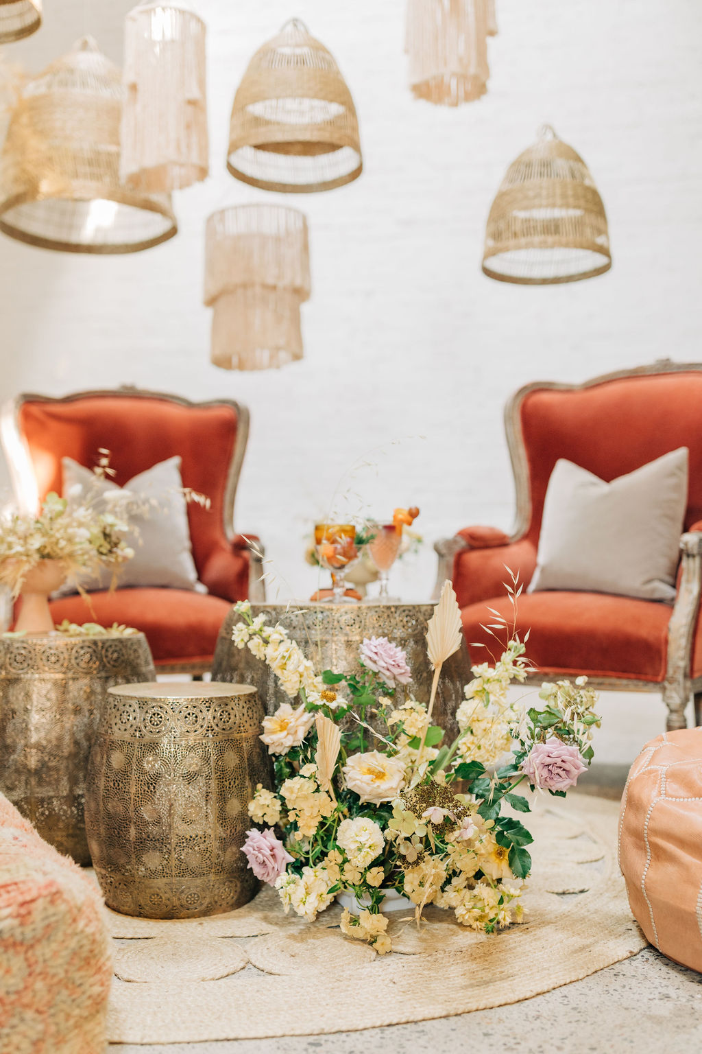 seating arrangement of velvet chairs and poufs