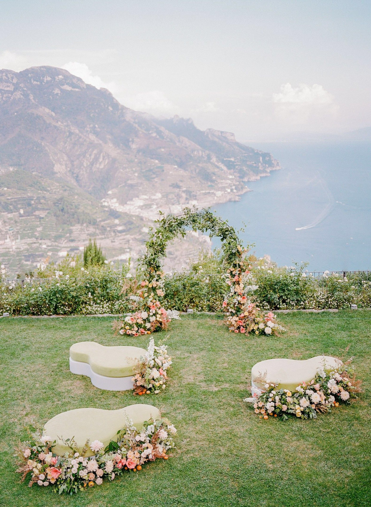 small wedding ceremony set up with mountain and ocean view