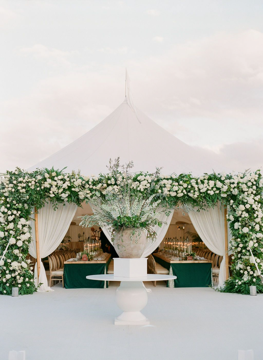 wedding reception tent with white flower decorations