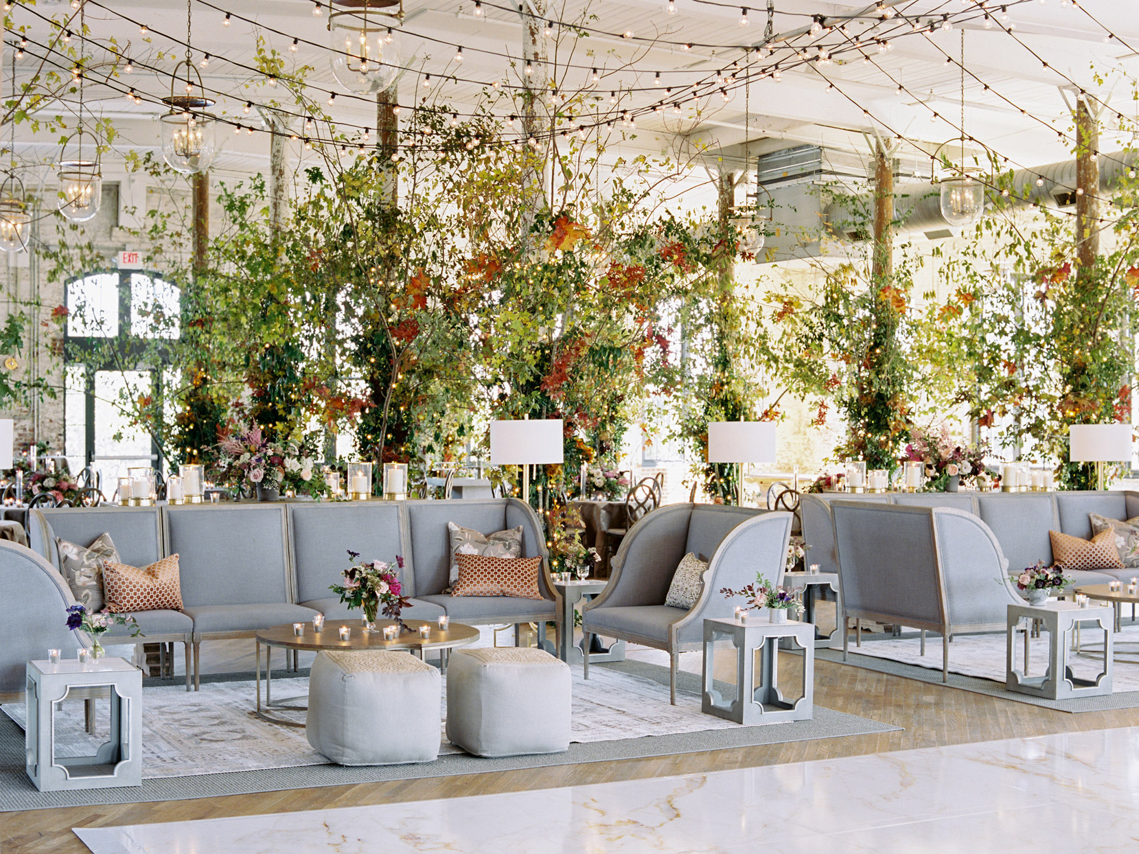 gray wedding lounge couches with greenery backdrop