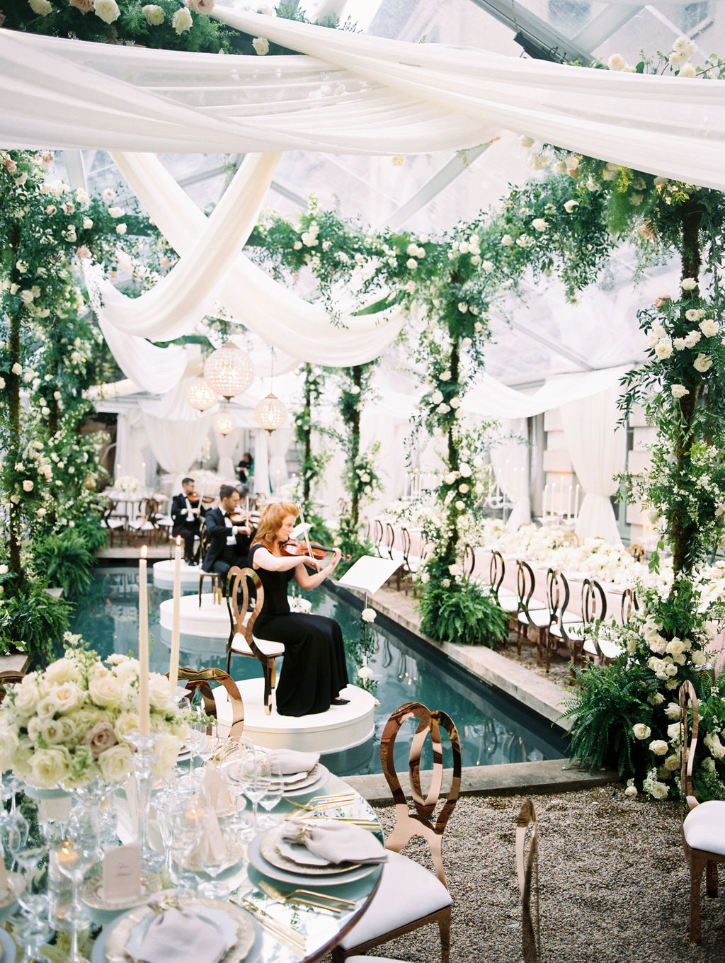 musicians playing for elegant wedding ceremony surrounded by florals