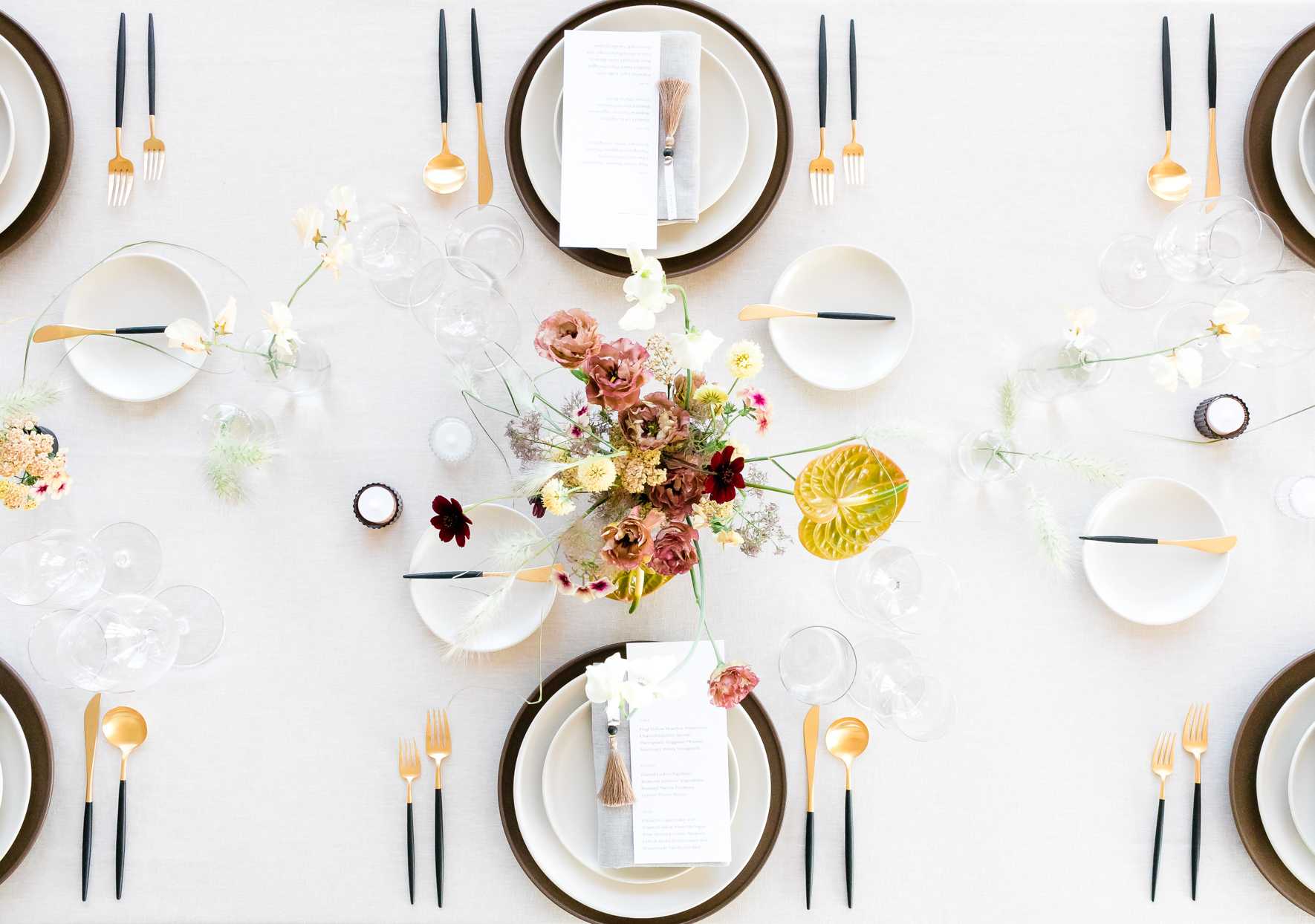 overhead view of simple wedding table with pink and florals