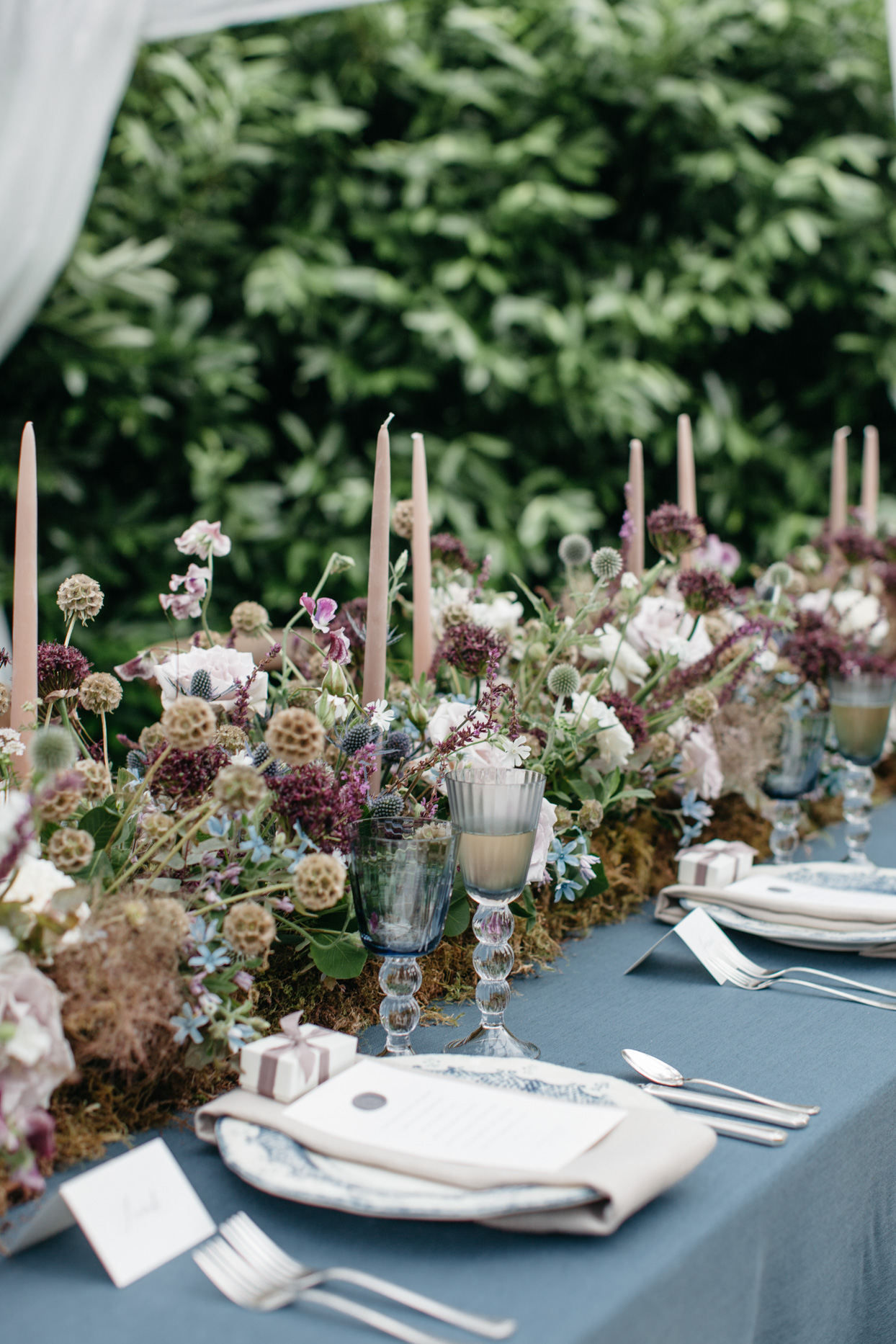 rustic brown, purple, and blue floral centerpiece on table