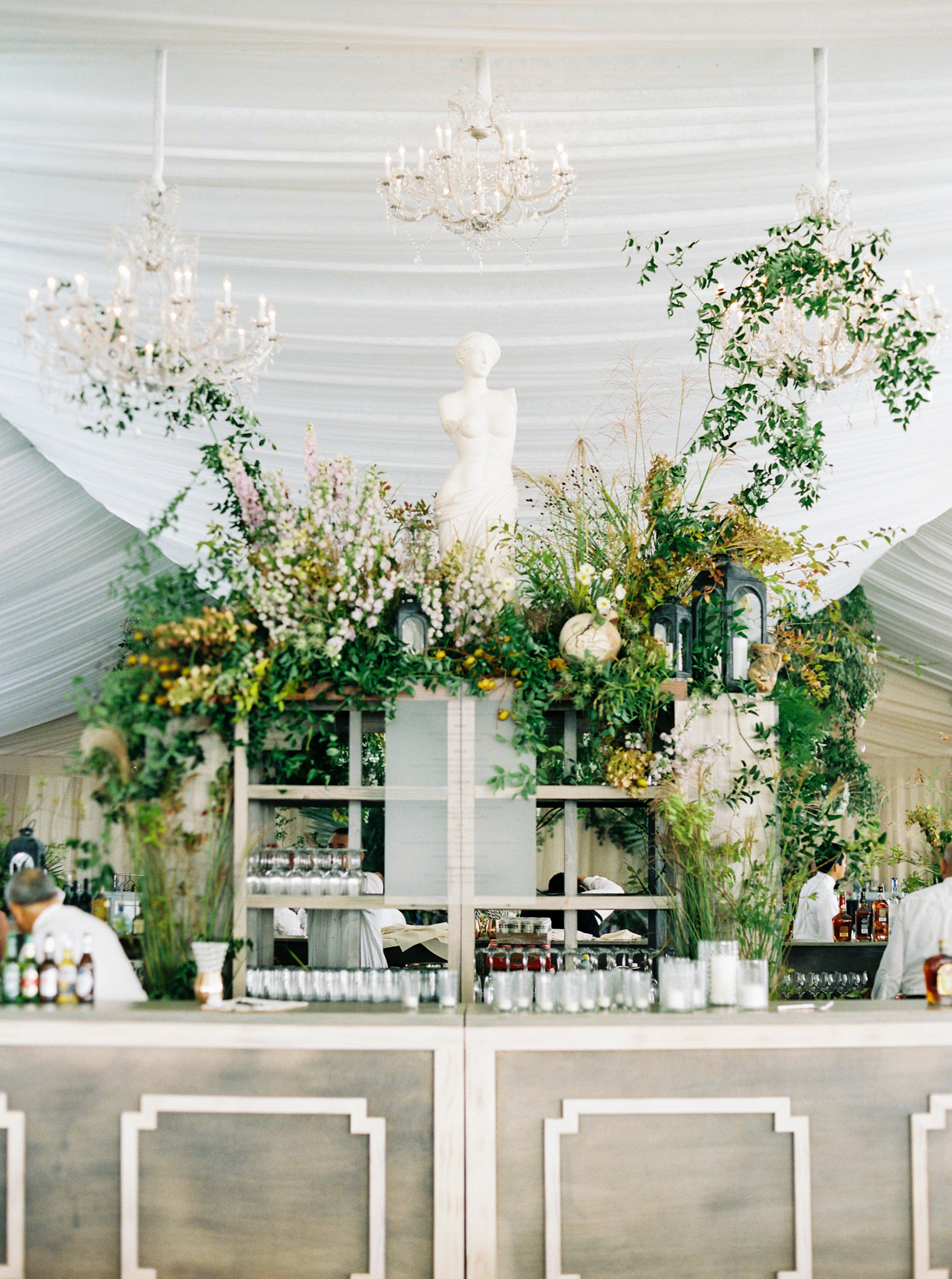 wedding bar with antique statue and neutral tones