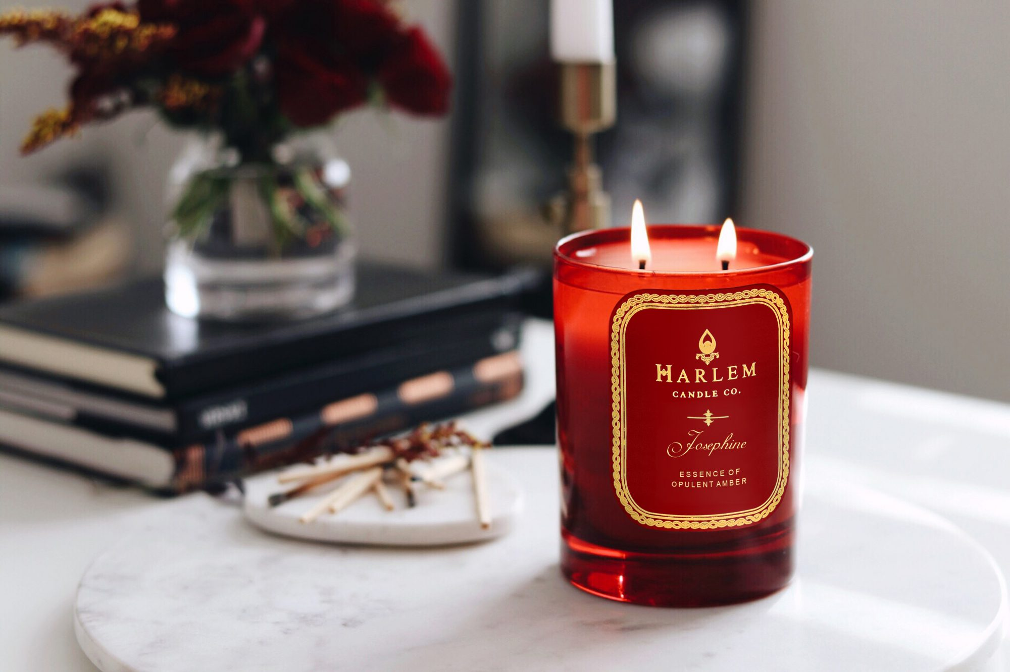 harlem candle company josephine candle in red vessel