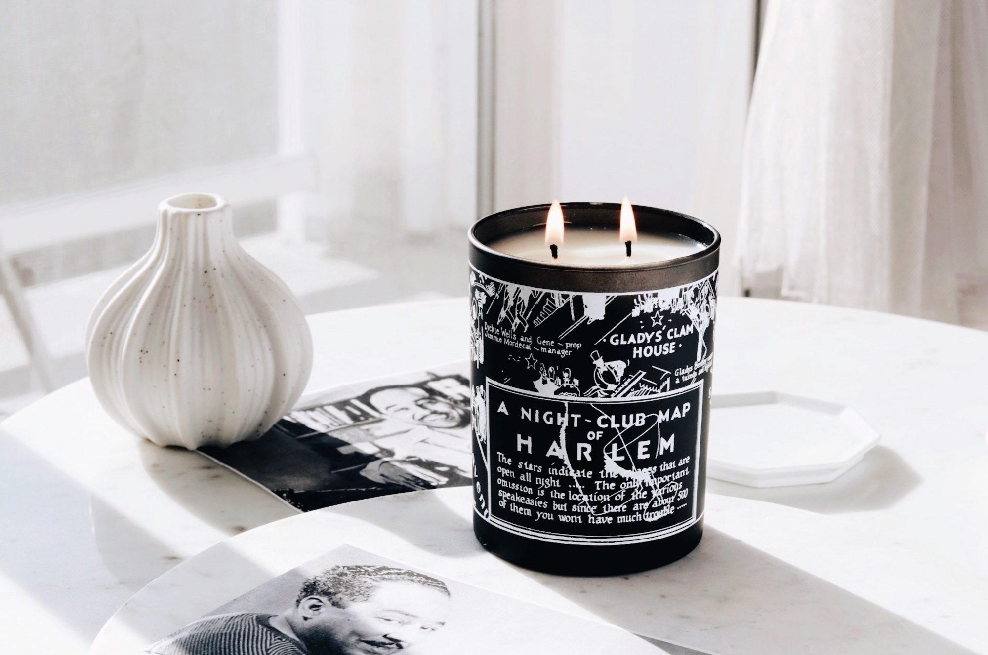 harlem candle company night club map candle surrounded by black and white images