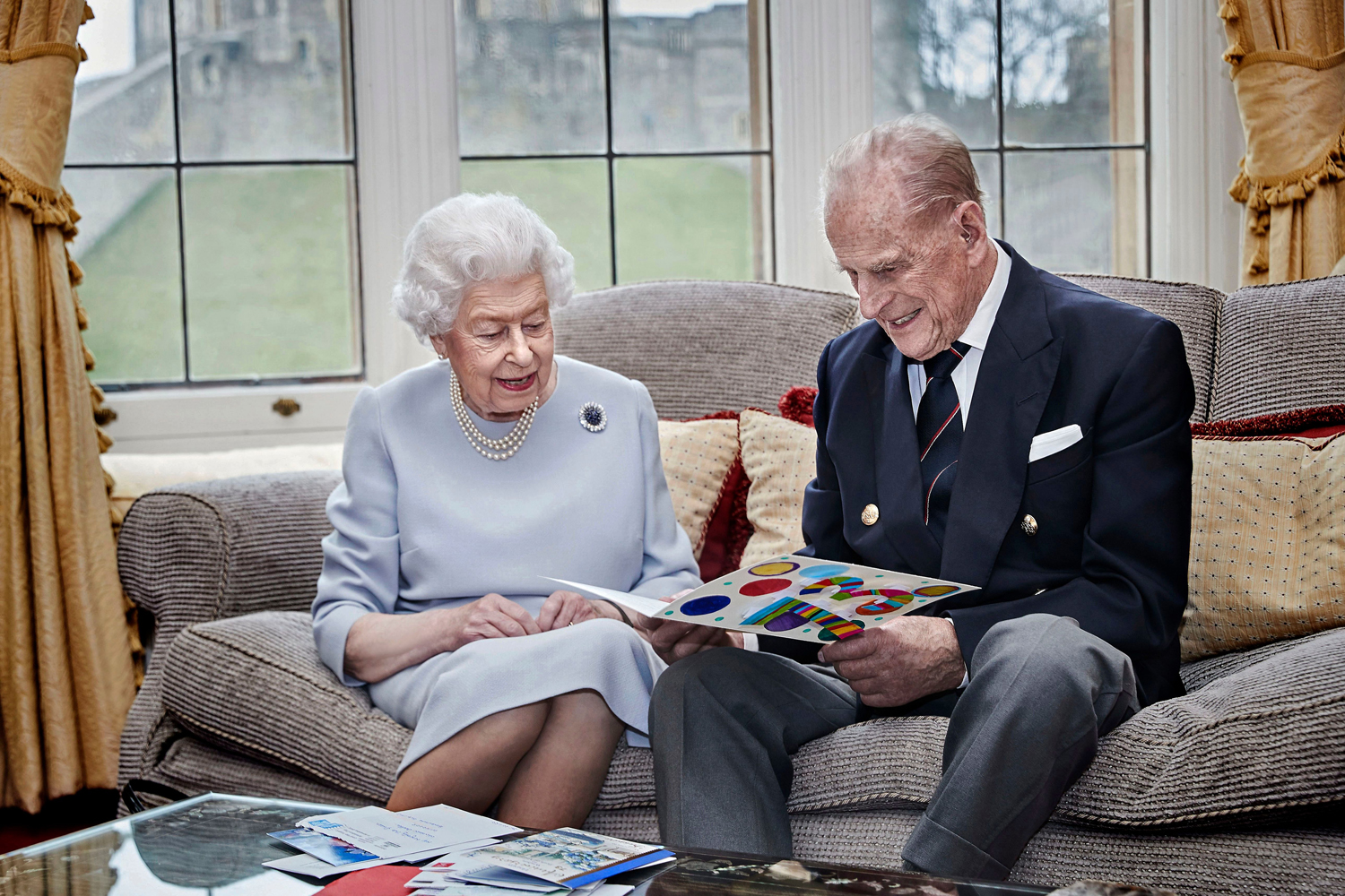Queen Elizabeth and Prince Philip Duke Of Edinburgh 73rd Wedding Anniversary Official Portrait in Windsor, United Kingdom holding a homemade card