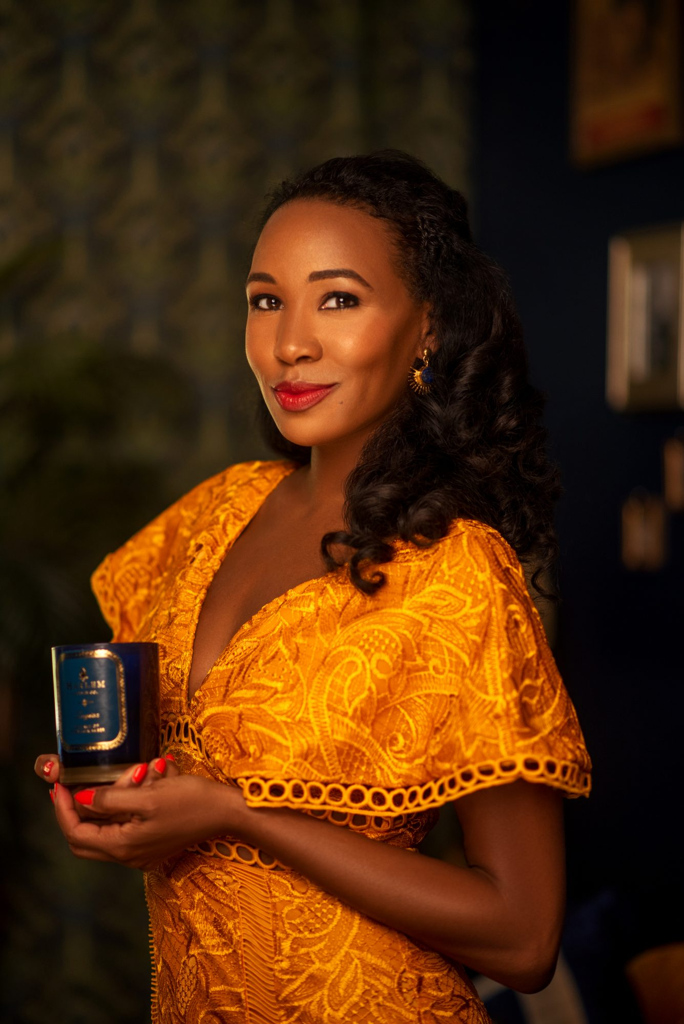 harlem candle company founder and ceo teri johnson holding signature candle