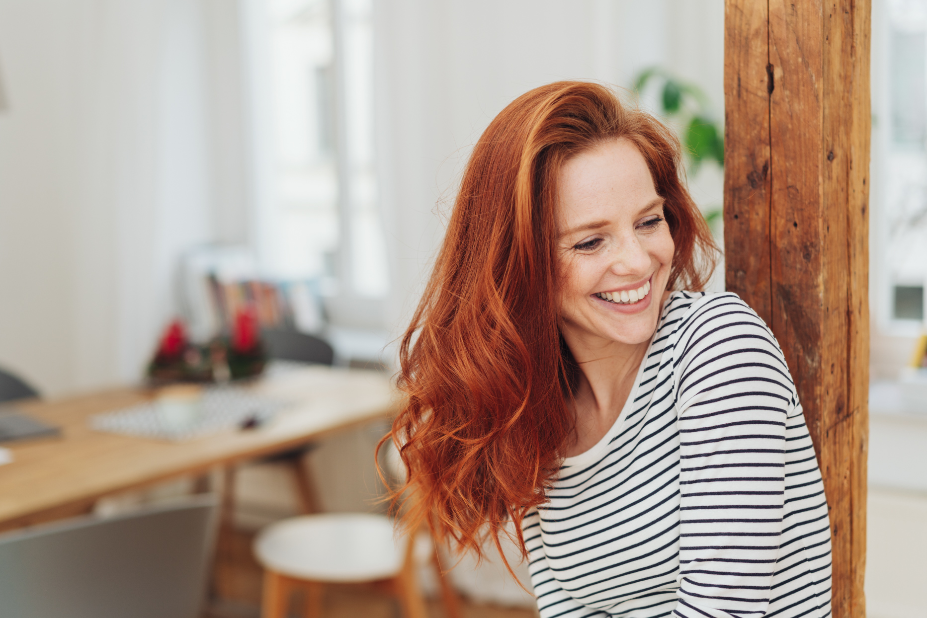 woman with wavy red hair