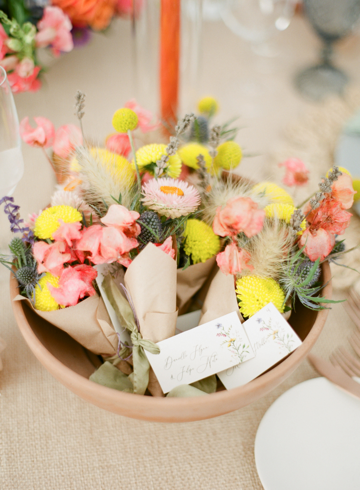 mini bright colorful wedding bouquets wrapped in brown paper