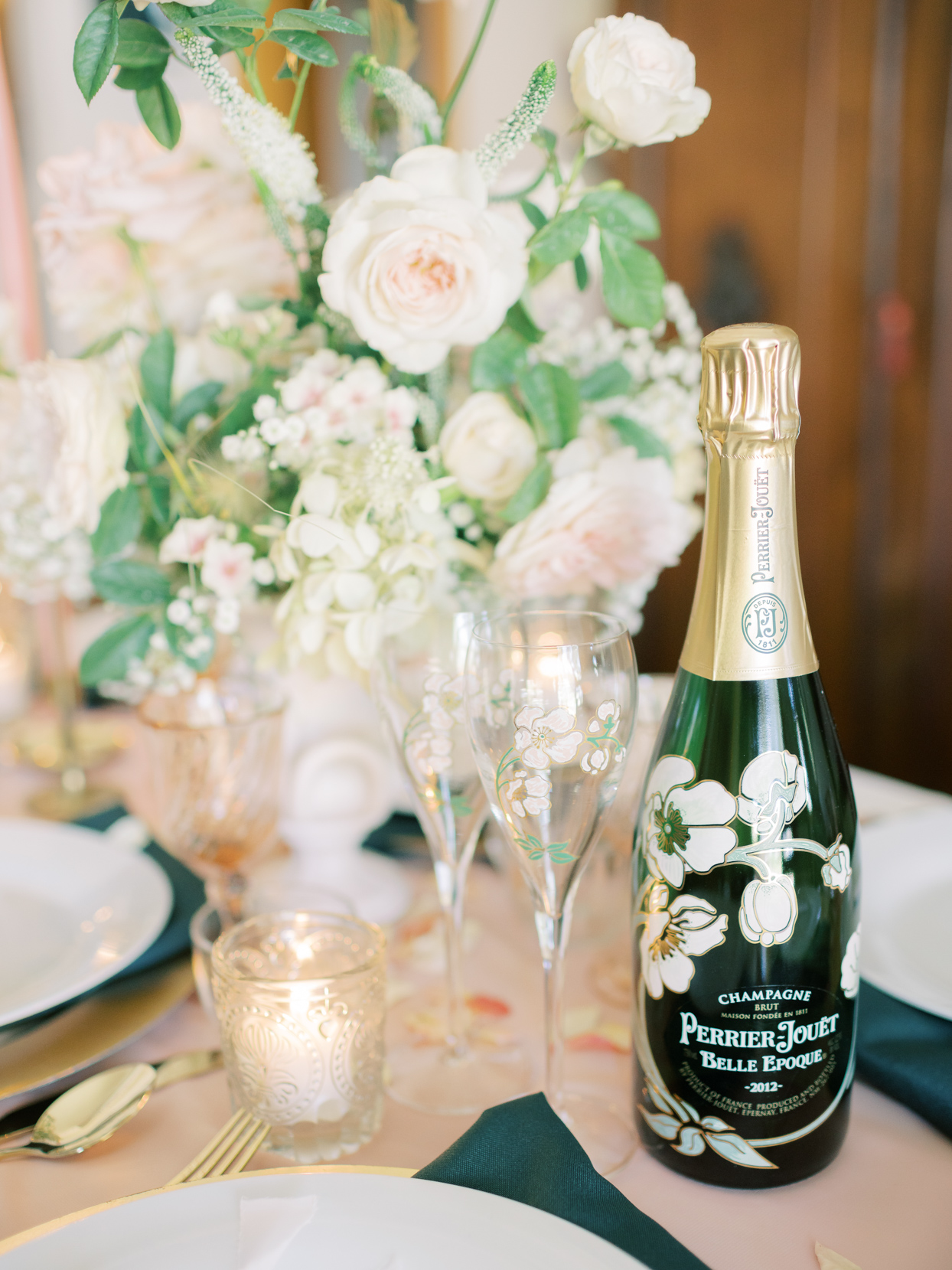 wedding champagne bottle and flowered glasses