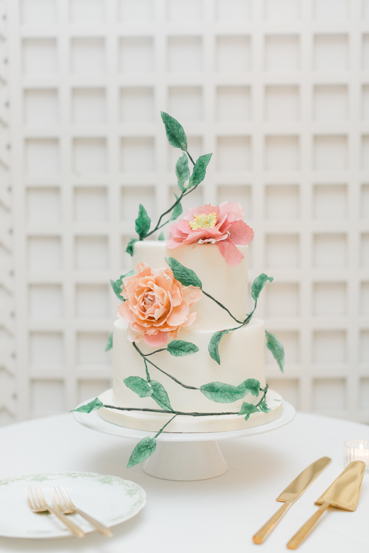 elegant white wedding cake with peach and coral flowers