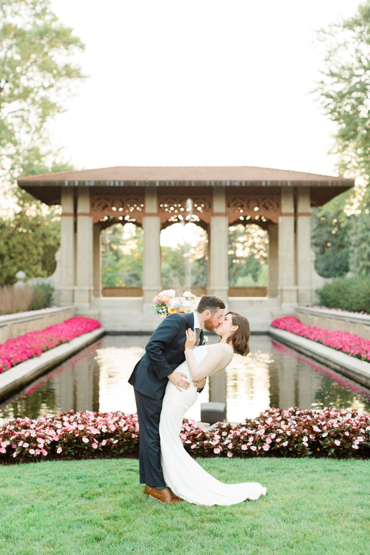 wedding couple kiss during garden ceremony