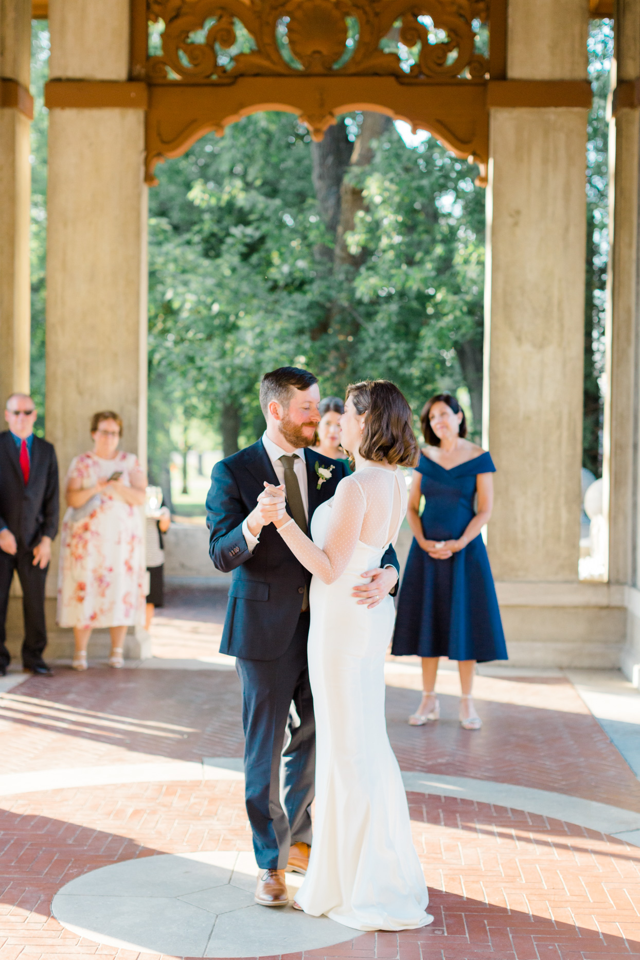 wedding first dance in outdoor garden structure