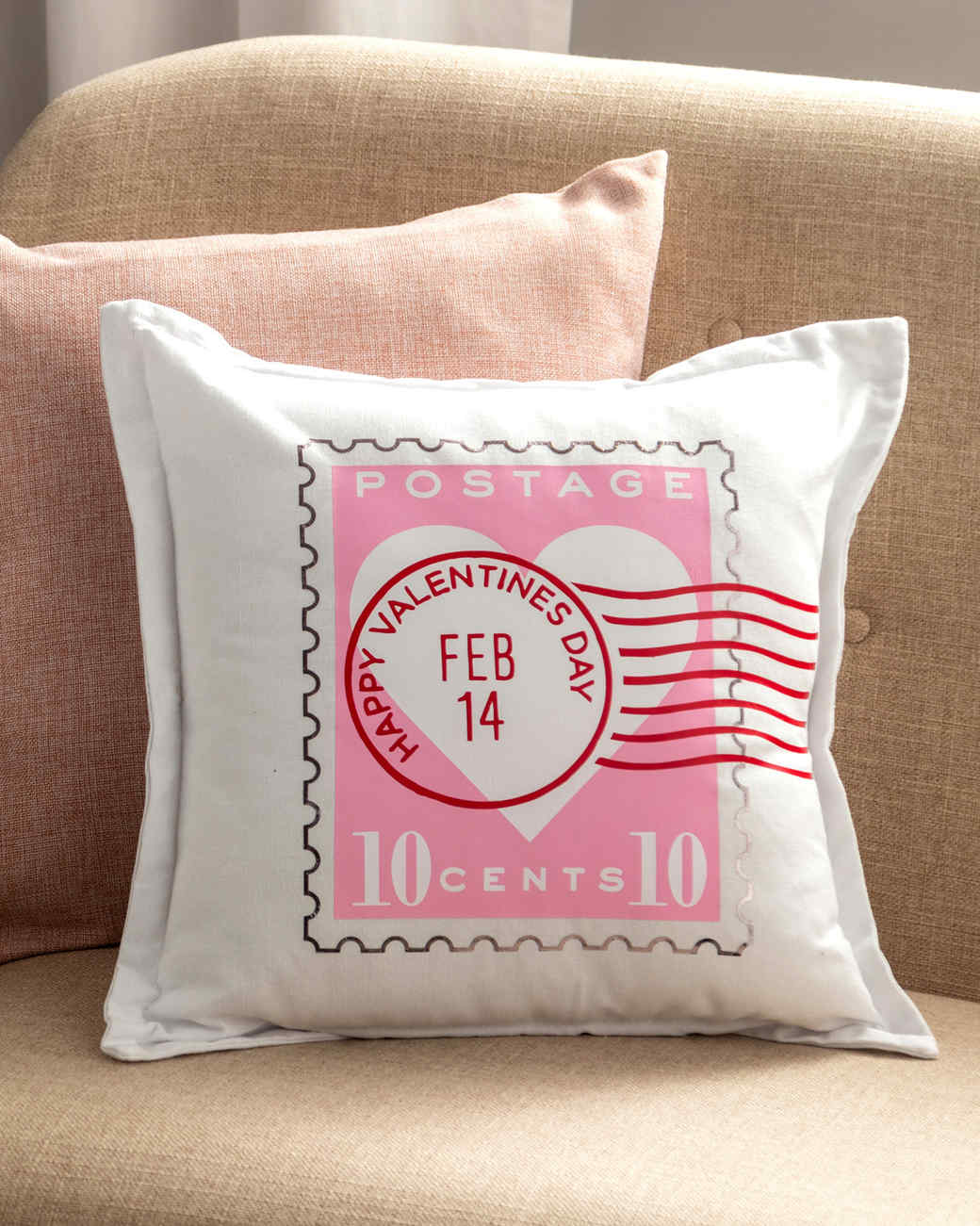 valentines stamp pillow on tan couch