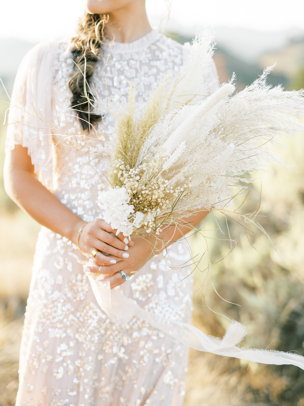 bride's rustic dried wild flower and twig bouquet