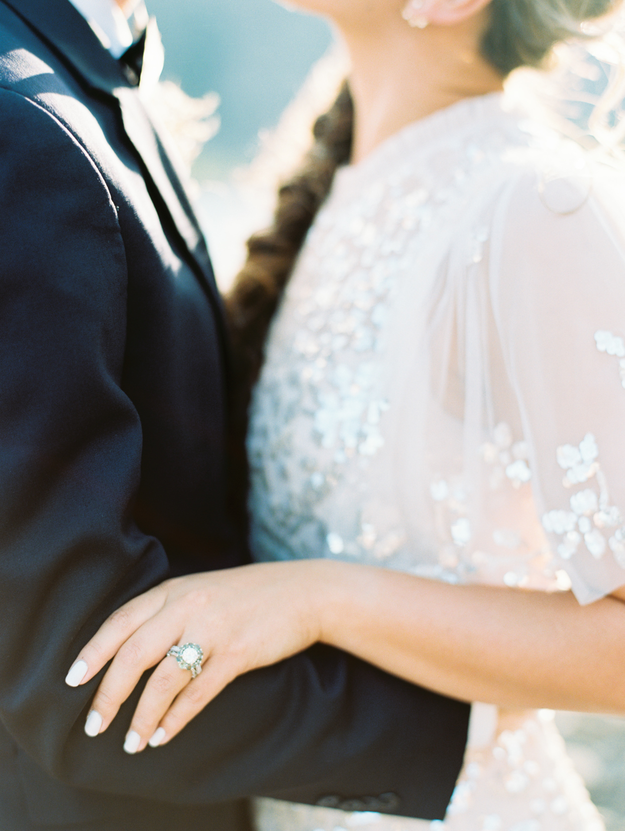 close up of bride and groom with large wedding ring